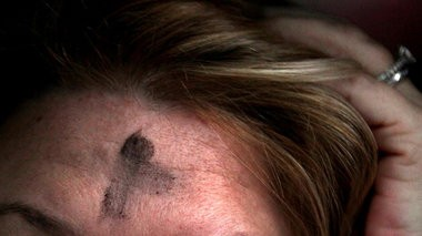 Jennifer Eshler received her ashes, seen in this close up detial image, from the driver's seat of her SUV from Rev. Sahra Harding outside the Stephane Tubbs Jones Transit Center in Cleveland for Ash Wednesday, February 13, 2013. (Marvin Fong / The Plain Dealer)