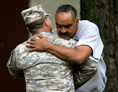 Felix DeJesus, right, father of missing teenager Gina DeJesus, is greeted outside his Cleveland home while waiting to hear information if his daughter has been found in 2006.
