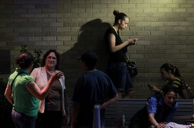 The wait outside MetroHealth Medical Center after Amanda Berry, Gina DeJesus and Michelle Knight were found in a house on Seymour Avenue, Monday, May 6, 2013. (Gus Chan, The Plain Dealer)