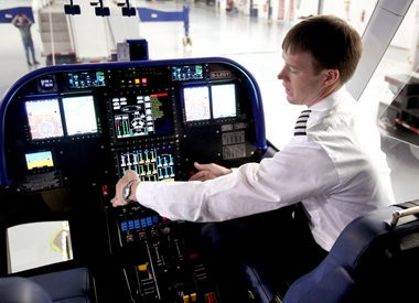 Assistant Pilot in Charge Michael Dougherty explains instrumentation inside the new Goodyear blimp at the Wingfoot Lake Hangar. (Marvin Fong / The Plain Dealer)