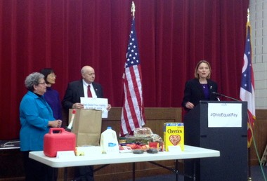 """Ohio Rep. Connie Pillich, D-Cincinnati, speaks at the Ohio Democratic Party headquarters in Columbus in recognition of """"Equal Pay Day."""" Groceries symbolize how much Ohio's families could additionally afford, should the average income of female workers rise."""