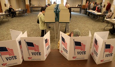 Voters use polling stations inside Bay Presbyterian Church in Bay Village, OH during Election Day, Tuesday, November 4, 2014. (Marvin Fong / The Plain Dealer)