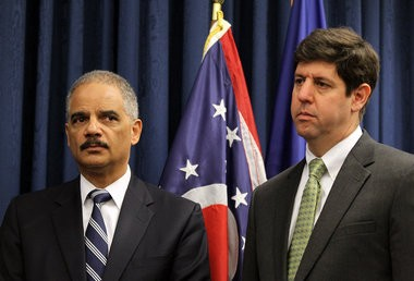 U.S. Attorney General Eric Holder, left, and U.S. Attorney Steven Dettelbach.