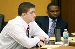 Cleveland police officer Michael Brelo listens to testimony during his trial.