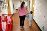 Mary Poole walks with her son Connor Griffiths, 5, at St. Augustine preschool in Cleveland, OH, Thursday, March 24, 2016. Poole received aid to get her son into this facility. (Marvin Fong / The Plain Dealer)