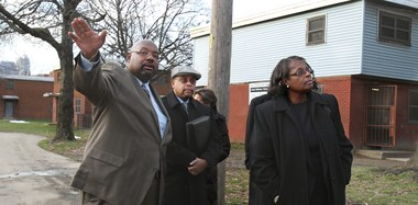 Jeffrey Patterson of the Cuyahoga Metropolitan Housing Authority explained construction plans to HUD Assistant Secretary Sandra Henriquez in January during a tour of the Cedar Extensions housing project, built in 1933. The housing project will be torn down and rebuilt using federal funds and private investment.