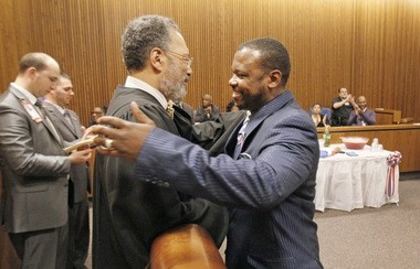 Army veteran Travis Edwards hugs Judge Charles L. Patton Jr. during the first graduation of Cleveland Municipal Court's Veterans Treatment Docket on Tuesday.