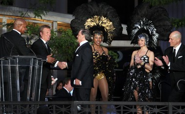 From left, Austin Carr and Fred McLeod congratulate Dan Gilbert last year at the grand opening of the Horseshoe Casino Cleveland, a downtown casino modeled, in part, on Detroit's Greektown Casino Hotel.