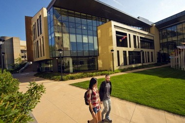 Students walk by Julka Hall at Cleveland State University