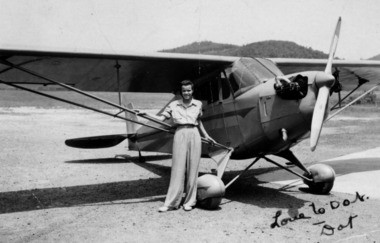 Dorothy Layne McIntyre next to her single-engine Piper Cub at West Virginia State College in 1940.