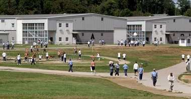Inmates walk on the grounds of the Noble Correctional Institution in Caldwell, Ohio.