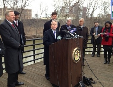 State and federal officials near the banks of the Mahoning River today as they announce charges against the owner of a Youngstown fracking company.