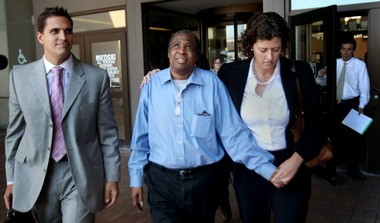 David Ayers, center, walks out of the Cuyahoga County Justice Center a free man in 2011 after serving 11 years in prison for a murder he didn't commit. Ayers won a $13.2 million verdict in federal court Friday. At right is Carrie Wood of the Innonence Project.