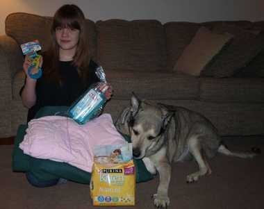 Harley Helman, 12, and Cheyenne, 10, look over some of the pet care items recently donated to Blankets Fur Beasties, the group Harley founded four years ago to collect supplies for local animal shelters.
