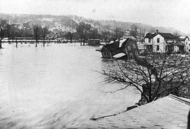 A house in the Peninsula area sinks on its foundation during the 1913 flood.
