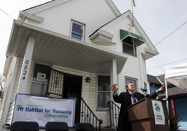 John Habat, executive director, Greater Cleveland Habitat for Humanity, announces a housing rehabilitation project for Clement Street in Slavic Village and Colfax Road in Lower Kinsman Thursday, April 4, 2013, at 6824 Clement Ave in Cleveland. (Peggy Turbett / The Plain Dealer)