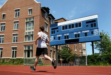 A student runs along the track at Case Field at Case Western Reserve University in the summer of 2012.