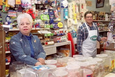 This 2001 photo shows Cesi Castro and his wife, Norma, in their grocery store, Caribe, on West 25th Street. The Castro family, among the first Hispanics to settle in Cleveland just after World War II, have strong business ties on the city's near West Side.