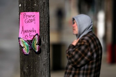 A homemade sign marks the West 110th Street and Lorain Avenue intersection where Amanda Berry was last seen before her abduction in April 2003.