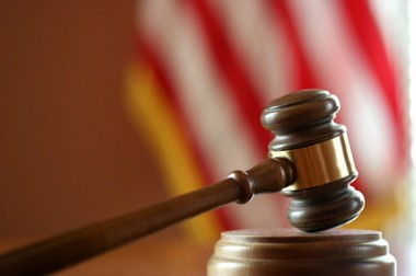 Two anti-government defendants are on trial for charges they conspired to steal $8 million from the IRS.