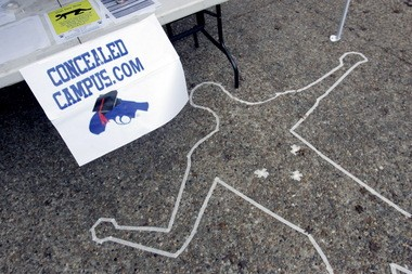 Signs and a replica of a crime scene draw attention to a booth on the campus of Texas State University-San Marcos in San Marcos in 2007 as members of Students for Concealed Carry argue that students and faculty should be allowed to carry concealed weapons on campus.
