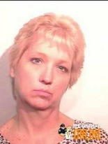 Debra Lashaway's booking photo was placed on a web site that posted mug shots, a move that has prompted her to take part in a class-action lawsuit in U.S. District Court in Toledo.