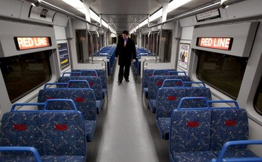 Casey Blaze, rail shop supervisor with RTA, walks through a newly renovated Red Line rail car. The car was almost completed gutted and fitted with new seats, wall panels, windows and lighting. The color scheme was changed to blue and gray, matching the look of RTA's HealthLine and its Blue Line cars.