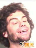 Phillip Kaplan sued web sites over the use of this booking photo.