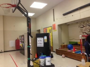 """An """"office"""" created with a wall of filing cabinets in the gym at Watterson-Lake elementary school."""