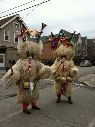 Two Kurents are seen on the streets of St. Clair-Superior at a time when their mythical winter-banishing attributes were either more successful or less needed.