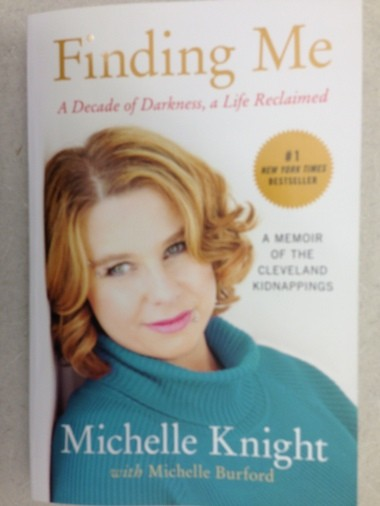Michelle Knight told the audience Saturday at the Cleveland Main Library she did her own hair and makeup for the cover of the new paperback edition of 'Finding Me,' newly published by Weinstein Books.