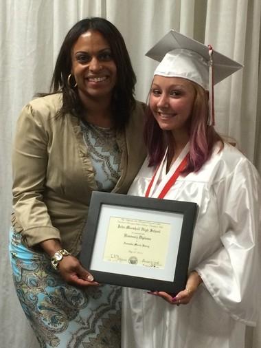 Amanda Berry with John Marshall High School principal Tiffany James and her honorary high school diploma.