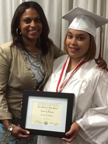 Gina DeJesus with John Marshall High School principal Tiffany James, who gave her an honorary diploma on Wednesday.
