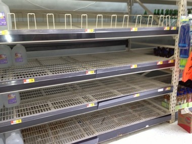 A display case for bottled water is barren Wednesday afternoon at a Toledo-area Walmart as residents stock up in case of a water emergency.