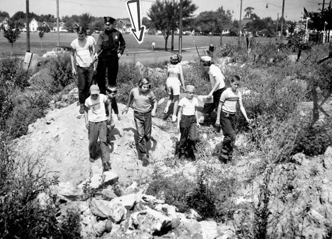 Police Officer Patrolman Robert McMahon and children volunteer searchers in late August of 1951 checking the Big Creek ravine/wooded area in Parma Heights for any clue in the disappearance of Beverly Potts. (Plain Dealer file photo)