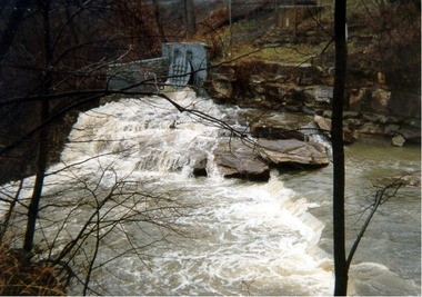 Combined sewage overflow pours from a pipe into the Mill Creek before a tunnel designed to end such overflows opened in 2012.