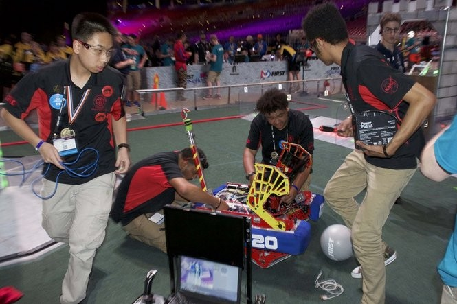 Students work on their robot in the national FIRST Robotics Competition.