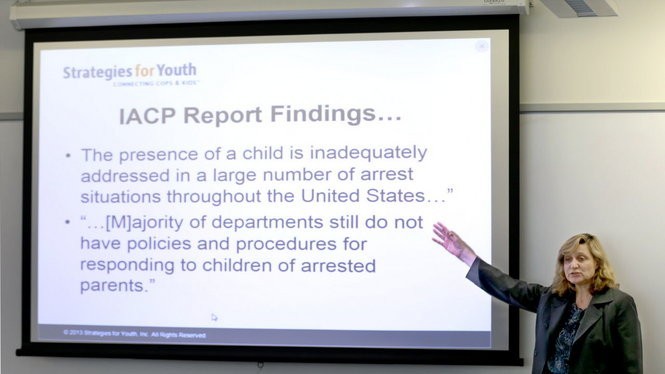 Lisa Thurau, Executive Director of Strategies for Youth, meets in March with Cleveland officers and outreach workers.