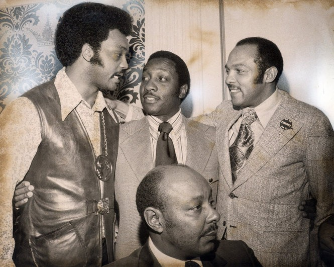 Pictured with Carl Stokes, right, are Jesse Jackson, left, Arnold Pinkney, center, and Louis Stokes, foreground, in 1971.