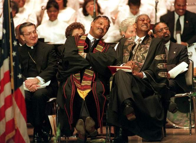 Bishop Pilla, left, sits next to the Rev. Jesse Jackson and the Rev. Otis Moss Jr. at a funeral service in 1996 for former Cleveland Mayor Carl Stokes. At far right is Mayor Michael R. White.