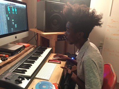 Charles Ke'ell Spooney, 18, of East Cleveland works in an editing suite on a verse that Maurice Philpott Jr. is recording.