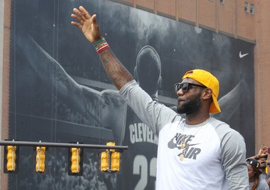 """Cleveland Cavaliers star LeBron James waves to fans during the victory parade on June 22, 2016. Several hundred thousand people jammed downtown to celebrate Cleveland's first major sports championship in 52 years. James, an Akron native, call it """"surreal.'' (John Kuntz, cleveland.com)"""