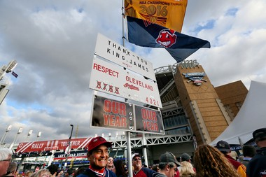John Rivera of North Royalton showed support for both the Cavaliers and the Indians with banners and signs as he walked around Gateway Plaza on Oct. 25, 2016. Cleveland Cavaliers and Indians fans headed downtown early to celebrate their hometown champions. The Cavs season opener began with a ring ceremony and raising of the NBA Championship banner, and the Tribe faces the Chicago Cubs in Game 1 of the World Series. (Lynn Ischay/The Plain Dealer)