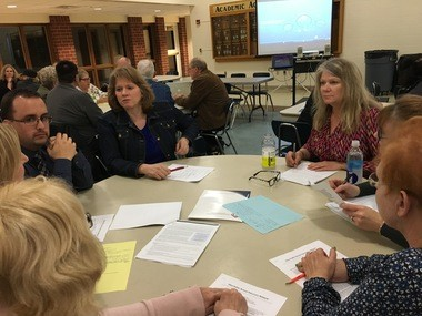Stare school board members Kathleen McGervey (back of table, left) and Lisa Woods (back of table, right) listed to concerns with the state's ESSA plan.