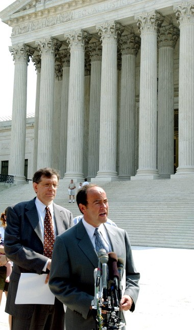 Attorney Clint Bolick, an early advocate of the Cleveland's school voucher program talks to the media in June 2002 in front of the Supreme Court. Behind Bollock is Rev. Barry Lynn, of the Americans United for Separation of Church and State.