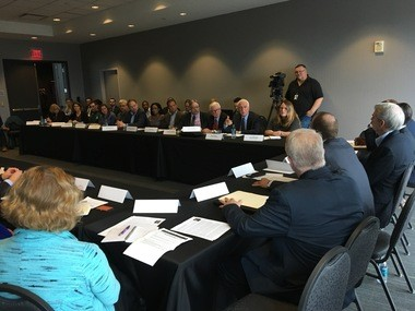 Senator Rob Portman, right, met with nearly 50 Lake Erie advocates Friday for a roundtable discussion focused on obtaining federal funding for the Great Lakes Restoration Initiative.