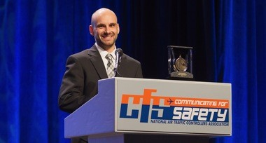 Avon air-traffic controller David Stempien accepting his medal at the 2017 NATCA safety conference last month in Las Vegas last month. He is credited with saving two lives by helping to guide a stricken aircraft to safety. (NATCA Photo)