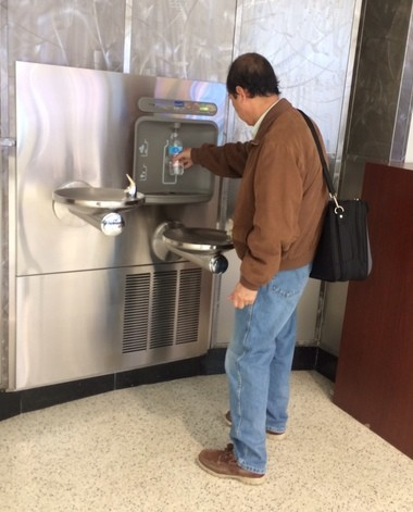 A passenger at Cleveland Hopkins International Airport refills a water bottle Thursday at a newly installed filling station near the Gate A security checkpoint. The filling stations are intended to provide customers with a free alternative to buying bottled water once they pass through security while at the same time, reducing the number of plastic bottles used by consumers.