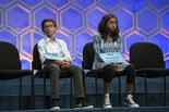 Rohan Rajeev, 14, a student of Remer's from Edmond, Okla., and Ananya Vinay, 12, from Fresno, Calif., wait to spell during the finals of the 90th Scripps National Spelling Bee in Oxon Hill, Md., Thursday, June 1, 2017.