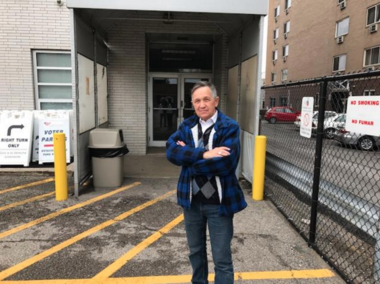 Former Congressman Dennis Kucinich stands in front of the back door of the Board of Elections Saturday afternoon.